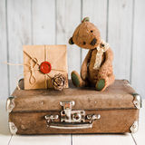 Teddy bear on a suitcase with love messages Royalty Free Stock Images