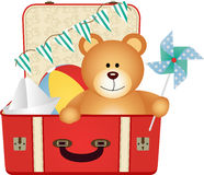 Teddy Bear in the Suitcase of Toys Stock Photo