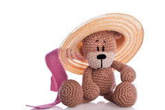 Teddy bear with sun hat and pink ribbon Royalty Free Stock Photos