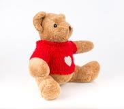 Teddy Bear sur le fond d'isolat plancher gentil b d'amour d'art mignon d'arc Photos libres de droits
