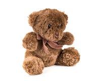 Teddy Bear sur le fond d'isolat plancher gentil b d'amour d'art mignon d'arc Image stock