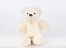 Teddy Bear sur le fond d'isolat plancher gentil b d'amour d'art mignon d'arc Photo libre de droits