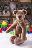 Teddy bear surrounded by blocks of children's plastic building kit Royalty Free Stock Images