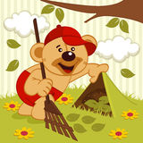 Teddy bear sweeps lawn Royalty Free Stock Photo
