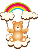 Teddy Bear in Swing Cloud Rainbow Stock Photo