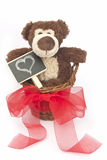Teddy bear with table. In a wicker basket Royalty Free Stock Photo
