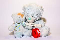 Teddy bear taking care of his son Royalty Free Stock Photos