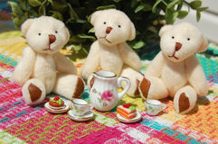Teddy Bear Tea Party. White teddy bears having a tea party with desserts Royalty Free Stock Image
