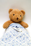 Teddy bear with a thermometer Stock Image