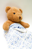 Teddy bear with a thermometer Stock Photography