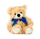 Teddy Bear toy. With blue bow isolated over white Stock Image