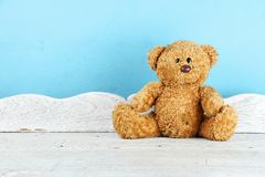 Teddy Bear toy alone on white wooden table. Stock Photo