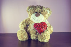 Teddy Bear toy alone on wood Royalty Free Stock Images