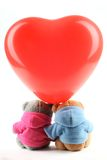Teddy bear toy with balloon Stock Images
