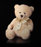 Teddy bear toy on the black background Royalty Free Stock Image