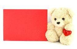 Teddy bear toy with a blank card Royalty Free Stock Images