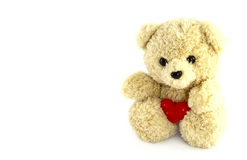 Teddy bear toy with heart. On white background Stock Photo