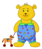 Teddy-bear with a toy horsy. The teddy-bear in the clothes decorated with flowers plays with a toy horsy Stock Images