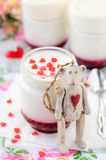 Teddy Bear Toy Leaning over a Jar of Yoghurt with Raspberry Jam Stock Photography