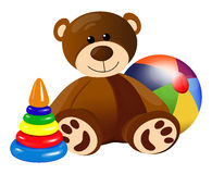 Teddy bear with toy pyramid and ball Stock Photo