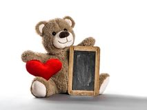 Teddy bear toy red heart chalkboard white background. Teddy bear toy with red heart and chalkboard on white background royalty free stock photos