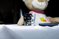 Teddy bear toy on the table with cup of coffee. Teddy bear toy on the table Royalty Free Stock Image