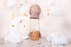 Teddy bear traveler and pilot. Childhood dreams. Stylish vintage children`s room with aerostat, balloons and textile clouds. Child