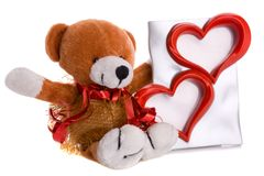 Teddy bear with two heart shape isolated Stock Photography