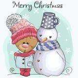 Teddy Bear in un cappuccio ed in un pupazzo di neve tricottati Immagine Stock