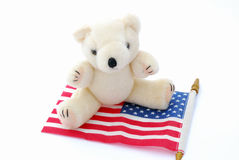 Teddy bear on USA flag Stock Image