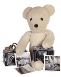 Teddy bear with vintage camera and photos Stock Photography