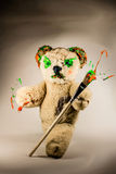 Teddy bear walking with paintbrush as a wizard Stock Photo