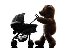 Teddy bear walking prams baby silhouette Royalty Free Stock Photo