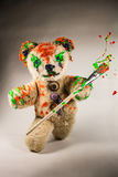 Teddy bear walks with bursting color Stock Images