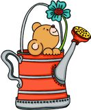 Teddy bear in watering can with flower Royalty Free Stock Photo