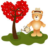 Teddy bear watering tree love Royalty Free Stock Images