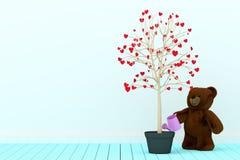 Teddy Bear Watering un árbol del amor fotos de archivo