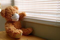 Free Teddy Bear Wearing A Face Mask, Sitting And Looking Out The Window With Loneliness And Sadness. Coronavirus Covid-19 And Pm2.5, Stock Photography - 189000662
