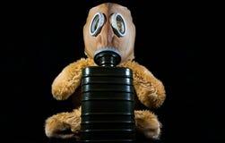 Teddy bear wearing a gas mask isolated стоковые фотографии rf