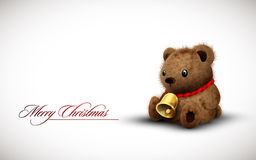 Teddy Bear wearing a Golden Bell as Necklace Stock Photo