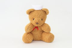 Teddy bear wearing a nurse hat. Stock Photos