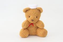 Teddy bear wearing a nurse hat. Teddy bear wearing a nurse hat on a white background stock photos