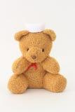 Teddy bear wearing a nurse hat. Teddy bear wearing a nurse hat on a white background stock images
