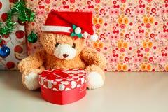 Teddy bear wearing a santa hat. Stock Photo