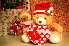 Teddy bear wearing a santa hat. Royalty Free Stock Image
