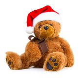 Teddy bear wearing a santa hat Stock Photo