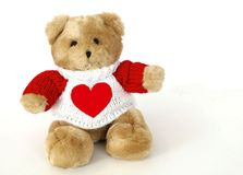 Teddy bear wearing sweater with heart. Brown teddy bear wearing knit sweater with heart Stock Photo