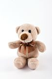 Teddy bear on white background. Isolated brown teddy bear sitting on white background Royalty Free Stock Photography