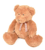 Teddy Bear on White Background. A stuffed brown teddy bear is on a white background with a bow. Use it for a childhood or toy concept Royalty Free Stock Images