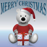Teddy bear white in red sweater red hat with present text MerryChristmas.  Royalty Free Stock Photos